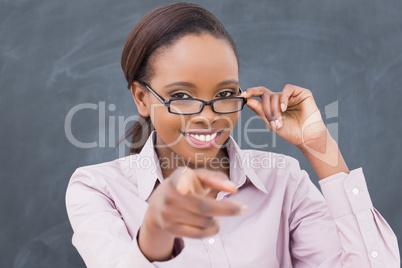 Teacher touching her glasses
