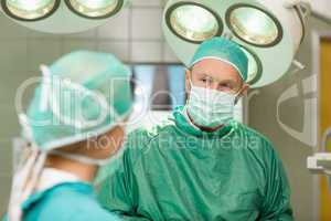 Two surgeons looking at each other