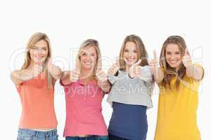 Girls sticking their thumbs up