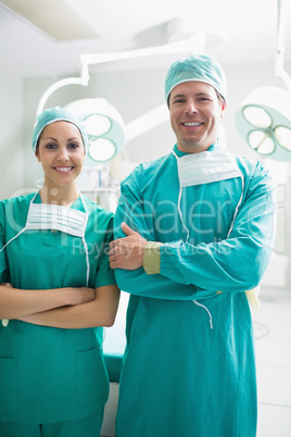 Surgeons looking at camera while smiling