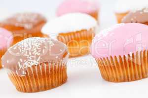 Muffins with icing sugar placed together