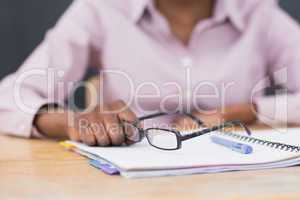 Close up of a notebook and glasses