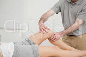 Knee of a woman being massaged by a physiotherapist