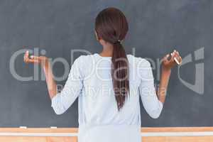 Black woman in front of a blackboard