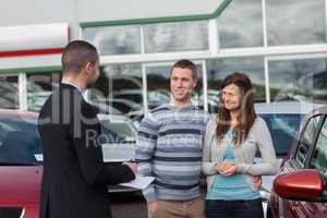 Salesman talking to a couple