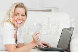Casual woman with a credit card and a laptop