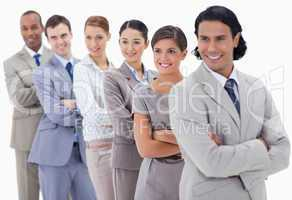 Big close-up of a business team in a single line looking towards