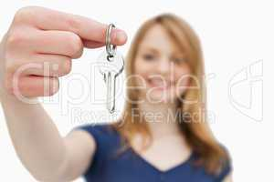 Focus shot on a woman holding a key