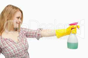 Blond-haired woman holding a spray bottle
