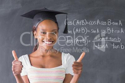 Student looking at camera with thumb up