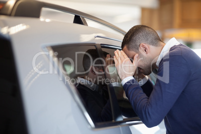 Client looking inside a car