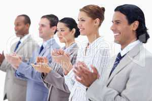Close-up of business people smiling and applauding