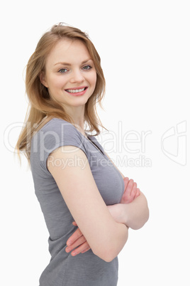 Side view of a woman smiling while looking at camera