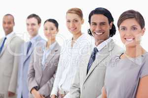 Close-up of smiling business people