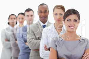 Close-up of a business team in a single line crossing their arms