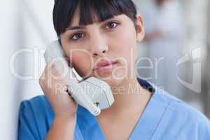 Nurse holding a phone