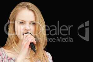 Young blonde-haired woman singing