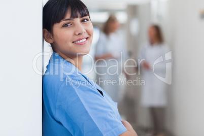 Nurse looking at camera in corridor