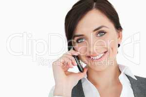 Happy businesswoman using a phone