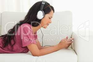 Young Latino frowning while listening to music