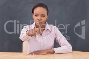 Serious teacher pointing of  finger
