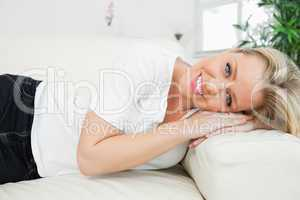 Woman resting her head on an armrest
