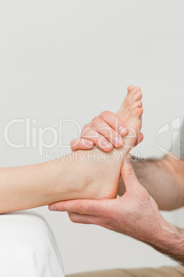 Hands of a physiotherapist massaging a foot
