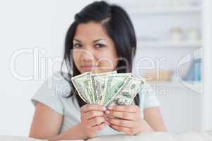 Woman holding four dollar bills