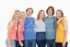 A group of friends holding each other and smiling