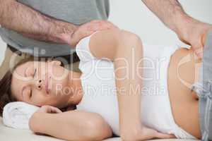 Brunette woman being massaged by her osteopath
