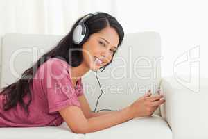 Young Latino smiling while listening to music