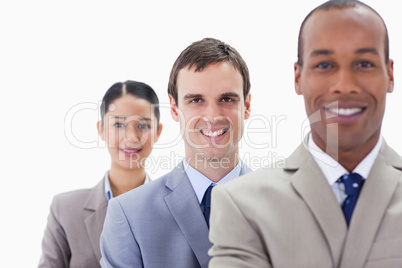 Big close-up of colleagues smiling in a single line