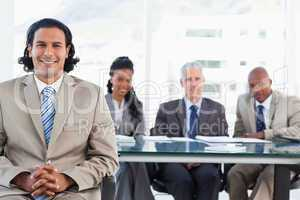 Businessman smiling while sitting with her hands crossed