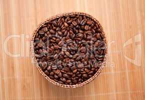 Roasted coffee seeds in a wooden basket