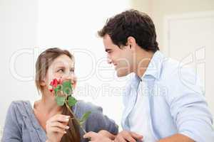 Man offering a rose to a Woman