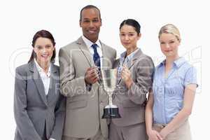 Close-up of a business team holding a cup