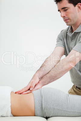Close-up of a masseur massaging the back of a woman