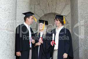 Happy graduates speaking together