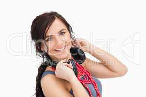 Modern young woman with a headphones around her neck