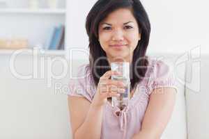Woman holding a glass of water