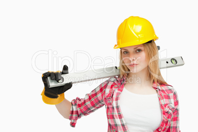Serious woman holding a spirit level