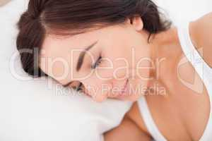 Peaceful woman lying while sleeping