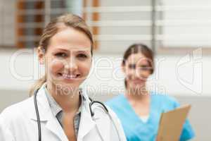 Doctor and and nurse standing