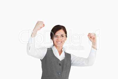Young woman in suit raising her fists