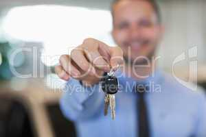 Man holding car keys by his fingertips