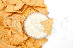 Bowl of dip surrounded by chips