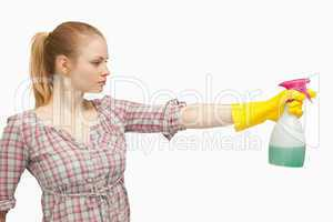 Joyful woman holding a spray bottle