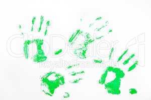 Four green handprints
