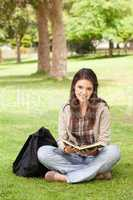 Teenager sitting with a textbook