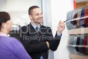 Smiling salesman pointing at a color palette